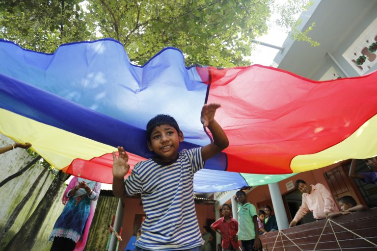 A child enjoys a play activity at the day care centre in Sylhet established by Apasen International and operated by our local partner, BRAC.